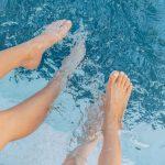 feet splashing in the hot tub water