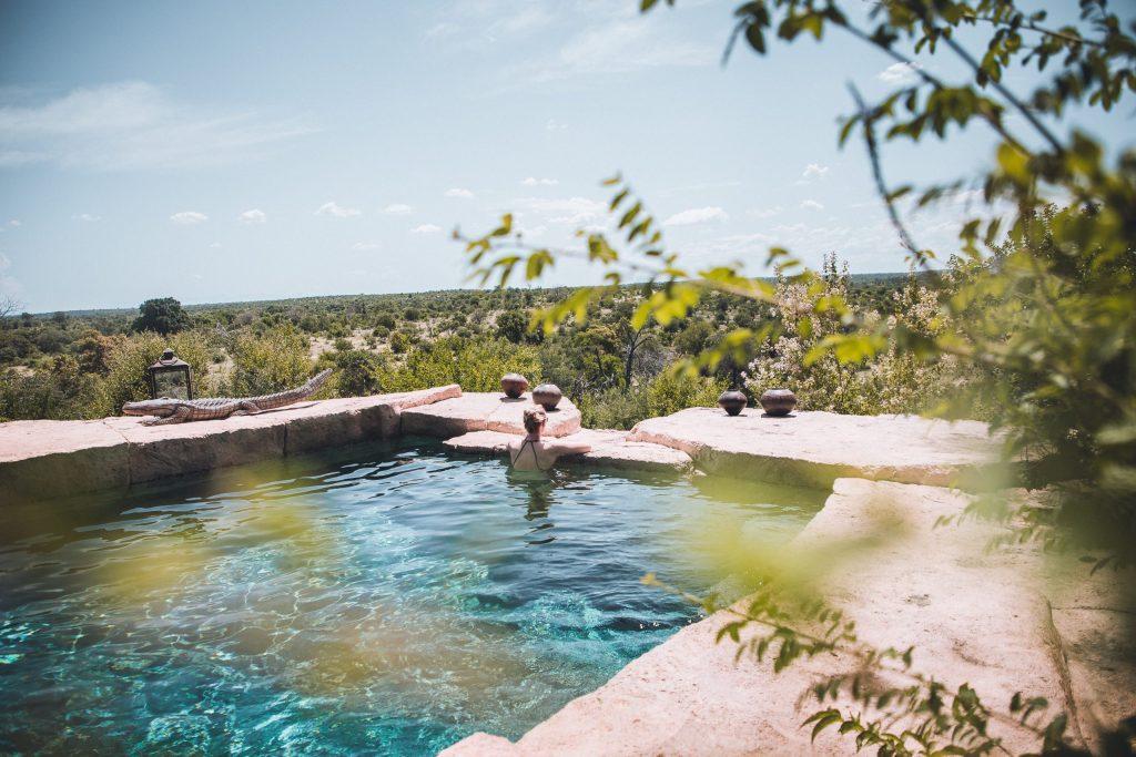 woman in large backyard spa