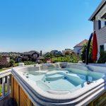 hot tub on backyard deck overlooking neighborhood